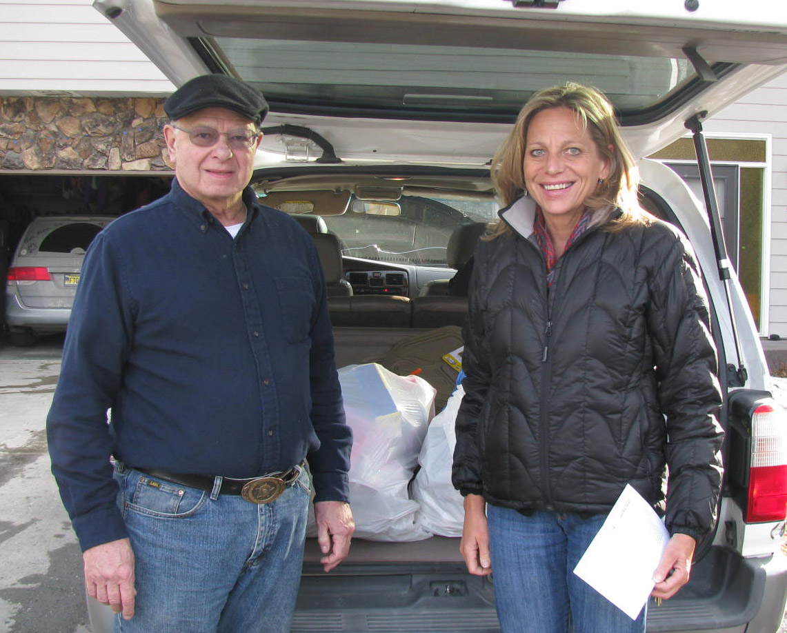 Bob McMorrow Sr. with Tricia Teasley of CSS delivering gloves for Brother Francis Shelter.