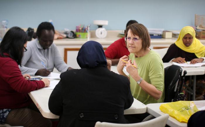 Volunteer teaching Citizenship class at the RAIS Welcome Center.